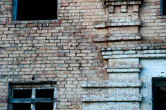 The wall of the destroyed building. The wall of the old destroyed building. Brick wall, broken Windows Royalty Free Stock Photo