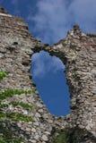 The wall of destroyed old medieval castle. Big hole in the wall of destroyed ruined old medieval castle in Khust, Ukraine stock image