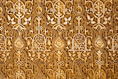 Wall detail in Alhambra of Granada, Spain. Ornated wall in Alhambra of Granada, Spain Royalty Free Stock Photos