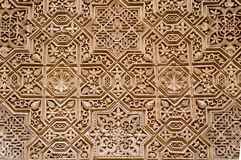 Wall detail with arab ornament in Alhambra, Granada, Spain. Royalty Free Stock Photography