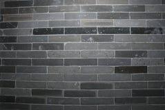 A wall. A detail of grey old brick wall Stock Photos