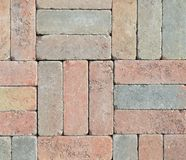Wall from different colored bricks put together Royalty Free Stock Photography