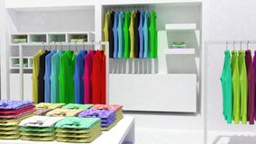 Wall display are and clothing rail. Wall display area of the shop and clothing rail with shop counter royalty free stock photo