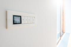 Wall display shows air temperature. Stock Photography