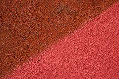 The wall is divided diagonally. Half pink, half red Royalty Free Stock Image