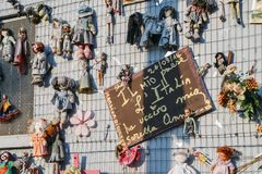 Wall of Dolls protest in Navigli district protesting against female physical and sexual violence, throughout the world Stock Photography