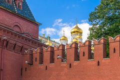 Wall and dooms of  Kremlin, Moscow. Kremlin wall and domes of  Cathedral of the Annunciation, Moscow Royalty Free Stock Image