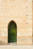 Wall and door. Old stone wall and green door Stock Photography