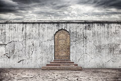 Wall with door on dry earth Royalty Free Stock Photo