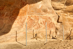 Wall in the Elands Bay cave with rock art Stock Image