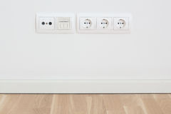 Wall with electric, TV, network plugs Royalty Free Stock Photos