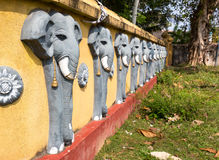 Wall with elephant sculptures in buddha temple Royalty Free Stock Photography