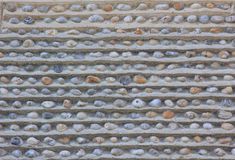Wall with embedded pebble stones. And concrete royalty free stock images