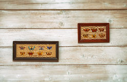 Wall with embroidered pictures. Royalty Free Stock Photography