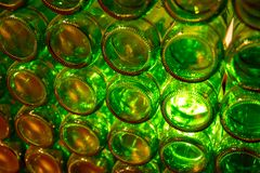 A wall of empty green bottles Stock Photos