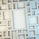 Wall of empty white frames. Stock Photo