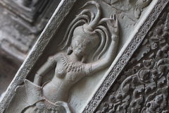 Wall engravings of devi dancers in Cambodia Royalty Free Stock Image