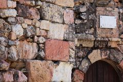 Wall of the entrance of a lighthouse. Close up of a wall of stones of a lighthouse wall with the entrance of background Royalty Free Stock Images