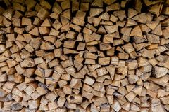 Woodpile, wall of evenly laid firewood royalty free stock image