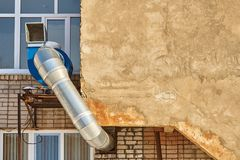 Wall and exhaust system. Exhaust system protruding from a brick wall Royalty Free Stock Image