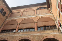 Wall facade of the inner courtyard of Palazzo Chigi-Saracini, Siena, Italy. Royalty Free Stock Photos