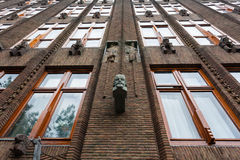 Wall of faces. Great example  of art nouveau architecture in Amsterdam , the Scheepvaarthuis building by Johan van der Mey Stock Images