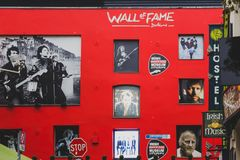 Wall of Fame in Dublin Temple Bar featuring images of the cit`s. DUBLIN, IRELAND - April 12th, 2018: Wall of Fame in Dublin Temple Bar featuring images of the Royalty Free Stock Photography