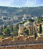 On the wall is fenced path for walks. The morning sun illuminates the dome. The Church  in Jerusalem. Battlements of Jerusalem surrounded by the majestic Stock Images