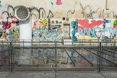 ¥The wall filled with graffiti near Center Pompidou in Paris Stock Photos