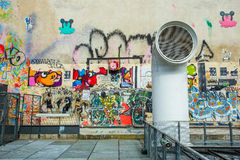 The wall filled with graffiti in Paris Royalty Free Stock Photography