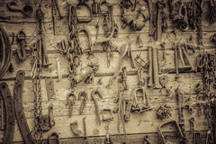 Wall Filled with Old Tools Hanging on the wall Royalty Free Stock Images