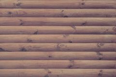 Wall is finished with a modern natural round brown timber as a background Stock Image