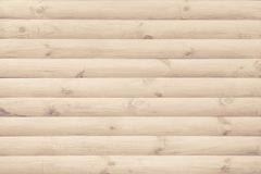 Wall is finished with a modern natural round unpainted timber as a background.  Royalty Free Stock Photography