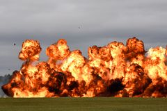 Wall of fire pyrotechnics explosion. Flames exploding from ignition erupting detonation. Flaming fire royalty free stock photography