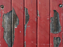 Wall with flaking red paint. Aged wooden wall with flaking red paint royalty free stock photo