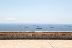 Wall with fleet of tankers behind Royalty Free Stock Photo