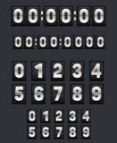Wall flipping clock and set of numbers. Royalty Free Stock Photo