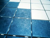 Wall and floor dark blue and white tile stock photos