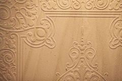 Wall with floral decorations Stock Image