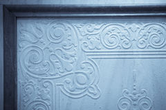 Wall with floral decorations Royalty Free Stock Images
