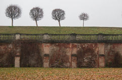 Wall in fog near Marly Palace. Peterhof. Russia. The Marly Palace.Peterhof in autumn. Saint Petersburg Surrounds. Russia Royalty Free Stock Photo