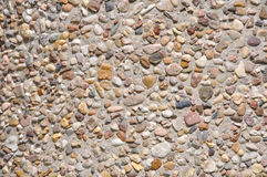 Wall form stones. Wall form small stones and concrete Royalty Free Stock Images