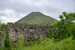 Wall of the Fort Lesendro, Montenegro. The wall of the fortress Lesendro with the mountain in the background Stock Photos