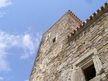 The wall of fortress. Walls of the fortress is against the background of blue sky Stock Photography
