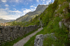 The wall of fortress. Footpath along the wall of fortress of the Kotor city, Montenegro Royalty Free Stock Image