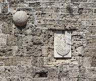 Wall of fortress  Rhodes castle close up with traces from bullets and shattered arms Stock Images