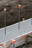 Wall foundation with rebar safety caps Stock Photography