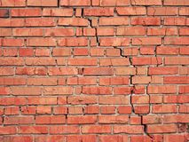 Wall fragment. From a red brick with a crack Royalty Free Stock Image