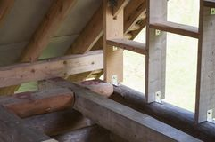 Wall frame and rafters on log house roof construction. Wall frame on log house attic and the rafters on log house roof construction royalty free stock images