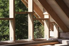 Wall frame and rafters on log house roof construction. Wall frame on log house attic and the rafters of roof construction stock photos